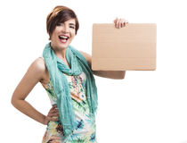 Happy woman with a cardboard Royalty Free Stock Photo
