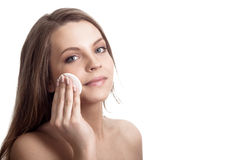 Happy woman caring about her face Stock Photos