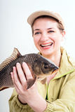 Happy woman with carp Stock Photography