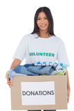Happy woman carrying donation box Royalty Free Stock Image