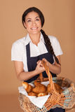 Happy woman carrying fresh croissants Royalty Free Stock Images