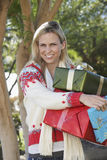 Happy Woman Carrying Gift Boxes Royalty Free Stock Photo