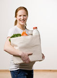 Happy woman carrying grocer bag Stock Photo