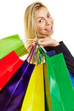 Happy woman carrying many shopping bags Royalty Free Stock Photography