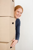 Happy Woman Carrying Moving Boxes Stock Photo