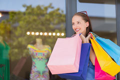 Happy woman carrying shopping bags Royalty Free Stock Image