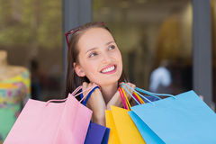 Happy woman carrying shopping bags Royalty Free Stock Images