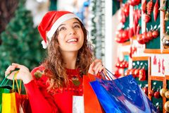 Happy Woman Carrying Shopping Bags Royalty Free Stock Photo