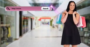 Happy woman carrying shopping bags in a shopping centre Stock Photos