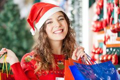 Happy Woman Carrying Shopping Bags At Store Stock Photos
