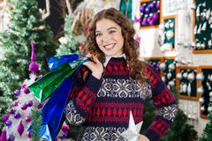 Happy Woman Carrying Shopping Bags In Store Stock Photography
