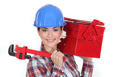 Happy woman carrying tools Stock Photos