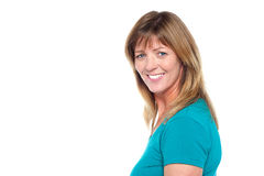 Happy woman in casuals posing sideways Royalty Free Stock Photography