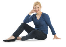 Happy Woman In Casuals Sitting Over White Background Stock Image