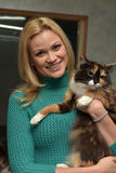 happy woman with a cat from a shelter Stock Image