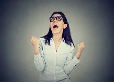 Happy woman celebrates success screaming Stock Images