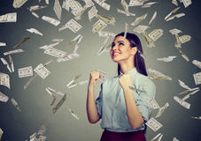 Happy woman celebrates success under money rain Royalty Free Stock Image