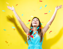Happy woman celebrating with confetti Stock Photo