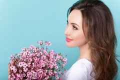 Happy woman celebrating event with flowers Stock Images