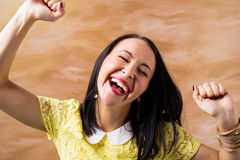 Happy woman celebrating with hands up Royalty Free Stock Photos