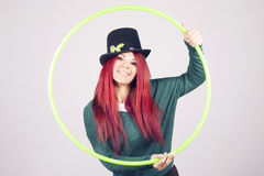 Happy woman celebrating Saint Patrick's day on march 17th. Smiling with a green hula hoop Royalty Free Stock Photos