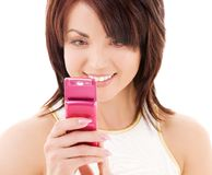 Happy woman with cell phone Royalty Free Stock Photo