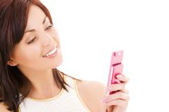 Happy woman with cell phone Stock Photos