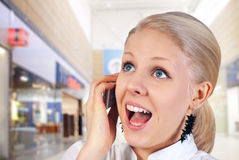 Happy woman with cell phone. Royalty Free Stock Images
