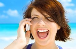 Happy woman with cell phone. Picture of happy woman with cell phone Royalty Free Stock Image