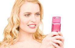 Happy woman with cell phone Royalty Free Stock Images
