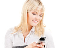 Happy woman with cell phone Royalty Free Stock Image