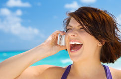 Happy woman with cell phone. Picture of happy woman with cell phone Royalty Free Stock Photos