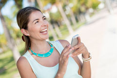 Happy woman with a cell phone Royalty Free Stock Photos