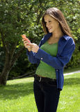 Happy woman with cellphone outdoor park Royalty Free Stock Photos