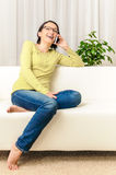 Happy woman chat smartphone living room copy space Stock Photos