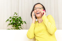 Happy woman chat two smart phones Royalty Free Stock Images