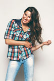 Happy woman in check shirt Stock Photo