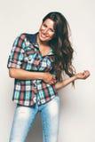 Happy woman in check shirt. In studio Stock Photo