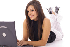 Happy woman checking emails on laptop Stock Image