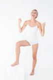 Happy woman cheering at camera Royalty Free Stock Photo