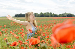 Happy Woman cheering in poppy field Royalty Free Stock Photos
