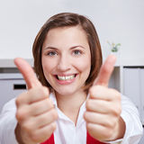 Happy woman cheering with two thumbs up Stock Photography