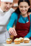 Happy woman and chef cook baking in kitchen Stock Image