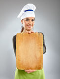 Happy woman chef holding a board Royalty Free Stock Images