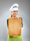 Happy woman chef holding a board Royalty Free Stock Photography