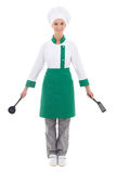 Happy woman in chef uniform with kitchen tools - full length iso Royalty Free Stock Photography