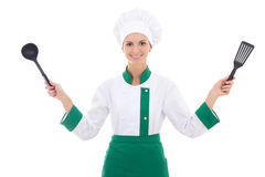 Happy woman in chef uniform with kitchen tools isolated on white Stock Photo