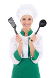 Happy woman in chef uniform with kitchen tools isolated on white Stock Images