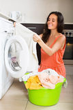Happy woman cheking white clothes Royalty Free Stock Photography