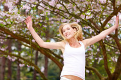 Happy woman and cherry blossom Royalty Free Stock Photos